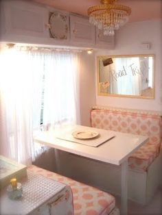 I would be so all over painting and reupholstering the interior of a camper or trailer. There is no need for it to look as dingy as they always seem to.