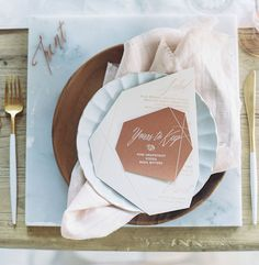 marble + copper + wood setting. geometric menu