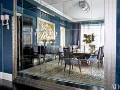 A Pratt & Lambert blue coats the walls of the once green dining room in a New York home decorated by Victoria Hagan Interiors; an expanse of mirror reflects the Émile-Jacques Ruhlmann table, French Art Deco chairs, and De Coene Frères buffet, which is from Karl Kemp Antiques.