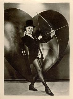 Betty Grable playing cupid perhaps?