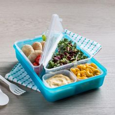 Bring all the food groups for lunch in our Snap Lunch Container. Four separate containers fit snugly in the large carrying container - great for packing snacks for picky eaters! Each container features a snap-on lid to prevent accidental spills in lunch bags and backpacks. A reusable fork and spoon clip into place on the lid so you'll never have to search the bottom of your bag for cutlery.
