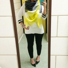 A simple black and white outfit with a pop of bright yellow thanks to this gorgeous blanket scarf.