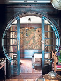 Circular sliding doors leading to art deco panel, designed by Hakan Ezer