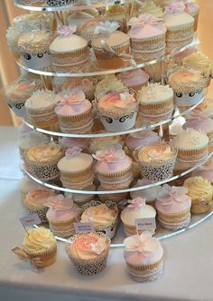 Vintage Wedding Cupcake Tower. Lace, Pearls and pretty wrappers. Pink, mocha and white. Orchids and rose swirls.