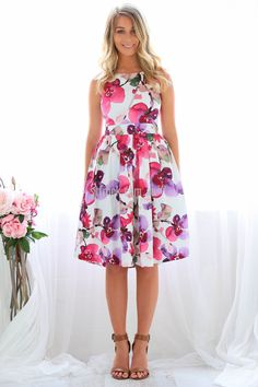 Wild Rose Dress in Floral $69.90  Blossom as bright as a bunch of roses (without the thorns) in the Wild Rose Dress!  Perfect for all your festive season events, this delightful sleeveless, fit and flare dress features a bright water colour inspired floral print complete with thick waist band, high neckline and invisible zip closure.   Styling tip - sweep your hair behind one ear, secure with pins, add a gorgeous pink or purple flower and complete your look with Samantha Wills Earrings!