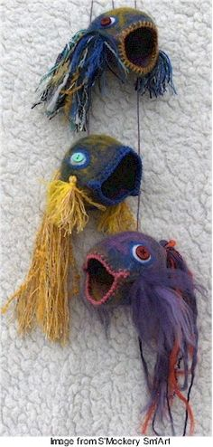 kay susan of S'Mockery Sm'Art  They are wet felted first, then finished off with a hand felting needle…The recipient called them 'singing fish' and says she is planning to put them on her Christmas Tree with little presents in their mouths.
