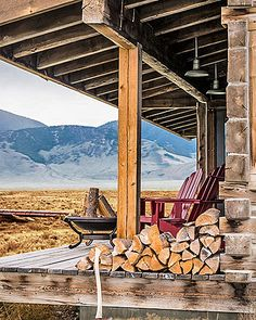 Gorgeous gardens, gorgeous porches. Mountain retreat. Red Adirondack chairs by Cost Plus World Market look out on the Lemhi and Lost River mountains from this Idaho cabin's back...