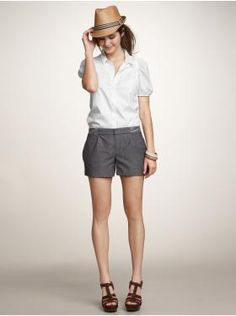 Not a fan of these hats I keep seeing, but I love this pair of shorts. And the shoes, and the blouse.