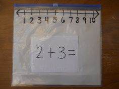 Mrs. T's First Grade Class:  My latest greatest math tool find. Draw a number line with sharpie on a ziploc slider bag and use the slider as the tool to add or subtract two numbers. I just filled the bags with addition and subtration cards. I put a piece of white paper in the bag also because it made the numbers a little easier to see.