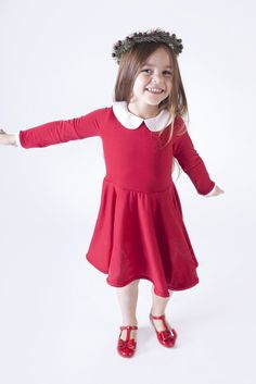 This is a comfortable and stylish addition to any little girls wardrobe. It is made out of the softest knit fabric int he perfect holiday red. It has stretch to it so it is easy for little babies and toddlers to be active in. This dress has a white peter pan collar, a keyhole back and a button closure, and is fully lined for extra warmth in the cooler months. All of the seams have been professionally serged for durability. Machine wash inside out delicate in cool or cold water. ...
