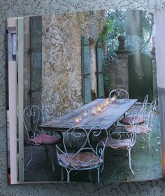 A gorgeous outdoor dining room from French Home by Josehpine Ryan. Bon appetit.