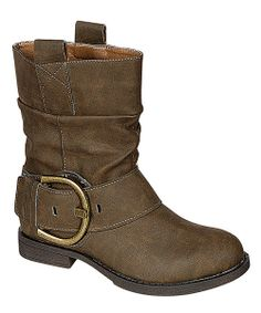 Undeniably chic, these boots will boost the style factor in any ensemble. Their short and sweet design features an oversize buckle detail and pull-tab straps.