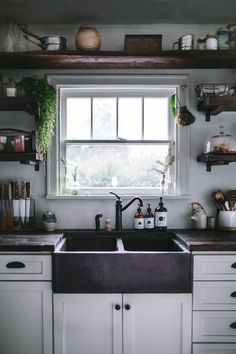 The apron-front, or farmhouse, sink has been a popular fixture in all kinds of kitchens for some time now, and with the rise in popularity of kitchens that mix traditional and modern elements, it feels more appropriate than ever. If you're considering adding one of these big beauties to your space, here's everything you need to know.