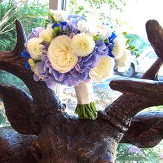 blue hydrangea, white garden roses, white ball dahlia, white freesia and blue delphinium. Sweet pea floral design ann arbor wedding detroit michigan wedding florist