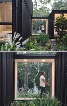 A window-lined bridge connects the main living spaces of this modern shipping container house to a single container that houses two bedrooms, and is placed slightly away from the main building to create courtyard-like outdoor spaces. #ShippingContainerHouse #Bridge #Windows #ModernArchitecture #BlackHouse