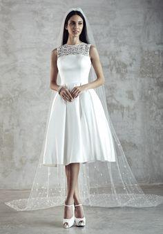Photographer: Gerald Goh from Imagerom Studio Code: MLC-B14-20052-IVY Description: Short satin dress with beaded shoulder element #weddings #melindalooi #melindalooiivory #ivory #bridal #weddingdress #bridaldress #weddinggown #gown #bridalgown #bride #vintage #embellishments #crystallized #swarovski #glassbeads #waterpearls #beading #beaded #tulle #frenchlace #lace #satin #silk #bridesmaid #veils
