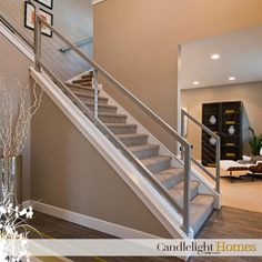 Candlelight Homes, Contemporary Staircase, The Views in South Jordan, Modern, Silver rail, Modern railing, Stairs, Front entry, Wood Floor, Wood flooring