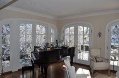 White winter room with black piano | DelysiaStyle