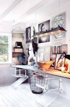 Lucite desk and gallery wall in home office