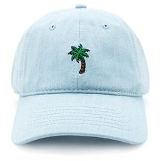 A denim baseball cap featuring an embroidered palm tree graphic in front and an adjustable strap back closure. Content + Care Shell & Embroidery 100% cotton Han...