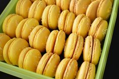 Yellow macaron shells with dessicated coconut