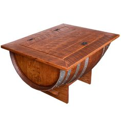 Beautiful wine barrel distressed finish coffee table boasts all the fine craftsmanship along with the elegance of detail. The distressed finish adds an additional element of design while the coffee table gives you plenty of hidden internal storage.
