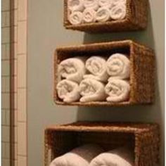 Such a cool way to store towels In bathroom/ I really need a neat way to put spare towels in the guest bath.