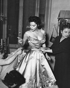 Ava Gardner being fitted before a fashion show in Rome. http://heres-looking-at-you-kid.tumblr.com/