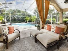 Pretty tropical lanai and screened in pool | Las Palmas Way in Monterey | Naples, Florida