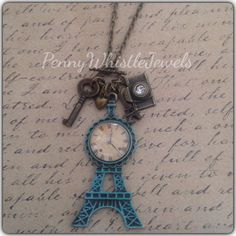 Eiffel Tower Charm Necklace, Paris Necklace, Paris Jewelry, Eiffel Tower Jewelry, Paris Jewellery, Charm Necklace, Vintage Inspired  This unique charm necklace is perfect for anyone. The clock is 25mm. Clock is a replica and does not work!! Eiffel Tower pendant has a patina glaze. Charms include a camera, key, Eiffel Tower, and heart. Chain is aprox. 26in.