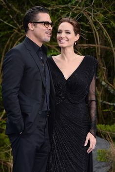 "Angelina Jolie and Brad Pitt attend a private reception as costumes and props from Disney's ""Maleficent"" are exhibited in support of Great Ormond Street Hospital at Kensington Palace on May 8, 2014 in London, England."