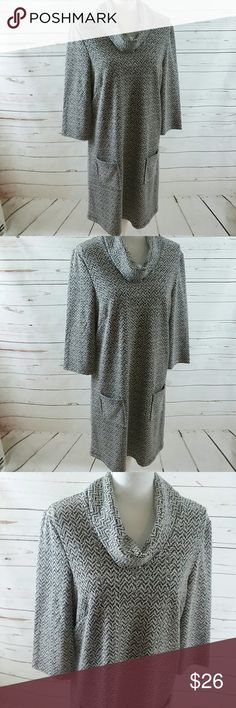 BLACK WHITE TWEED COWL NECK TUNIC DRESS Lg This is a lovely North style brand black and white ladies tunic dress. It has pockets on the front. It is size large. It is 66 polyester and 34% cotton for Comfort. It is in like new condition and sold without flaws or stains. North Style Dresses Midi