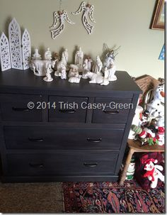 This Christmas, however, the nativity, and all the little additions I have added over the years, have found a new home on this lovely chest of drawers that my hubby gave me for Christmas! (next to the neighboring subdivision of Snowmen).