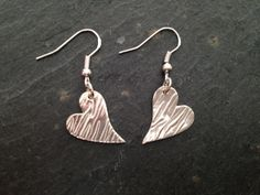 Embossed with a zebra print these wonky heart earrings are made with fine silver. The hearts are approximately tall and at the widest point and comes on sterling silver ear wires Mat. Clay Earrings, Heart Earrings, Drop Earrings, Metal Jewelry, Silver Jewelry, Precious Metal Clay, Matching Necklaces, Organza Bags, Zebra Print