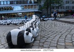 KIEL, GERMANY - AUGUST 14 2013: The WWF draws attention to the endangered giant panda with an action in the city of Kiel - stock photo