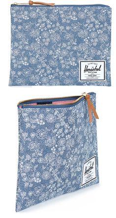 This large size pouch is made with a floral chambray print exterior and features a fully lined storage compartment with a exposed brass zip closure for secure storage making it perfect for day-to-day use   Herschel Supply Co.