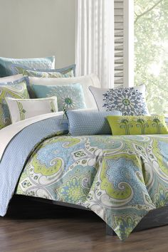 Loving how this over-scaled paisley print duvet adds a bright, bold look to this bedroom space. The best part? The reverse offers an airy blue diamond print to give your bedroom a more neutral look!