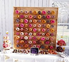 a mini rustic donut wall with glazed donuts