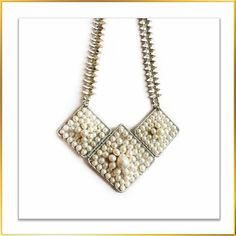 The Hierarchy Necklace is sure to turn the heads.White beads are cascading into three rhombus shaped frames and chain has beed studded with marquise shaped glass stones.  DM for enquiries.
