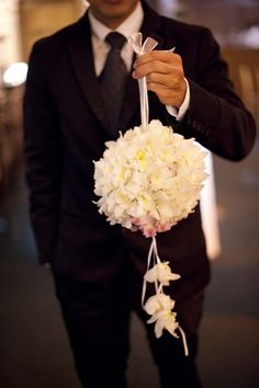Grace Ormonde Wedding Style Platinum Member Tantawan Bloom New York, NY; Location: Cipriani 42nd Street New York, NY; White cymbidium orchid pomander ball with ivory ribbon garlands.  Photography: M. Benedicte Verley Photography Providence, RI. http://www.weddingstylemagazine.com/photo-galleries/bouquets