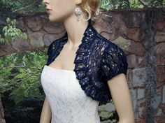 Navy Blue short sleeve corded lace wedding bolero jacket is a navy blue puff short sleeve bolero jacket made of bridal corded lace with ruffled edges. The lace is very soft and comfortable, yet has so much details in it. The bolero is v Navy Bridesmaid Dresses, Wedding Dresses, Lace Bolero Jacket, Lace Wedding, Wedding Bolero, Strapless Dress, Bodycon Dress, Navy Blue Shorts, Blue Lace