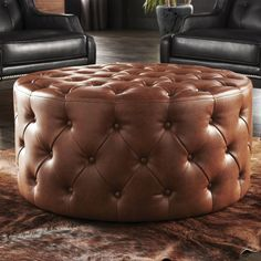 Grand in scale and style, the Sunpan Modern Regatta Ottoman is a button-tufted beauty. As fashionable as it is functional, this round ottoman. Round Leather Ottoman, Tufted Leather Ottoman, Leather Cocktail Ottoman, Round Ottoman, Leather Chairs, Leather Poof, Bonded Leather, Accent Furniture, Couches