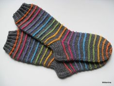 Inspired by the dainty lilac flower and starting with a scalloped edge, these socks are knit from the cuff down and embellished with flowers created b Fair Isle Knitting, Knitting Socks, Mitten Gloves, Mittens, Knitting Projects, Knitting Patterns, Winter Socks, Yarn Bombing, Crazy Socks