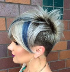 funky blonde pixie with dark roots and blue highlights