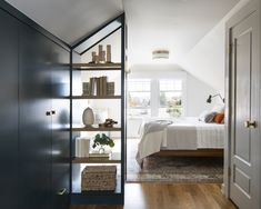 The light-filled master bedroom offers a mix of closed and open storage. Attic Renovation, Attic Remodel, Residential Interior Design, Home Interior Design, Bedroom Wardrobe, Master Bedroom, Master Suite Bedroom, Master Bath, Seattle Homes