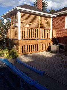 View from the west.  Eaves trough and lattice sun screen completed 21 Sep 2014