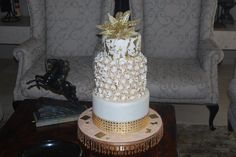 A spectacular wedding cake in white,silver and gold - Belle's Patisserie