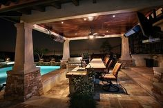 I love the stone/stucco columns and the stained wood ceiling by leila