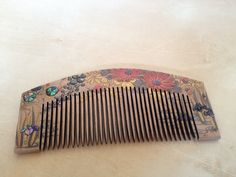 Early Showa Period comb done in lacquer with shell inlays.