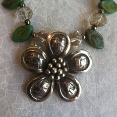 HILL TRIBE SILVER FLOWER NECKLACE Hill Tribes silver focal flower and clasp are so pretty and is surrounded with smoky quartz beads and leaves. As with most of the jewelry I create, this is one of a kind. Jewelry Necklaces